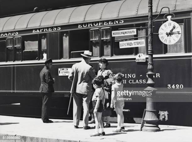 The Orient Express pauses on its way through Bulgaria While the engines are changed the passengers disembark and stroll about glad for the...