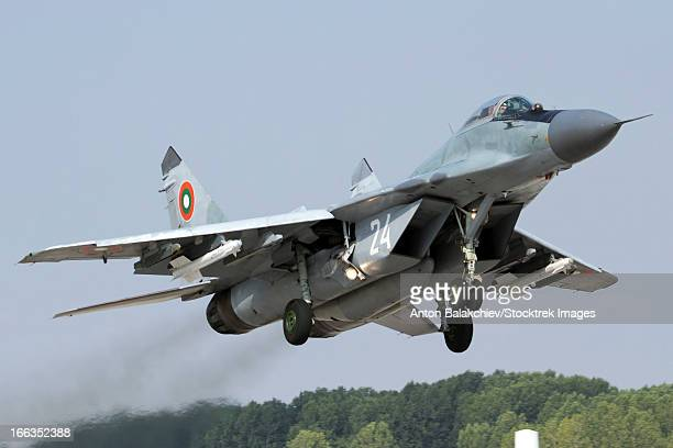 Bulgarian Air Force MiG-29 jet fighter departing with two AA-11 Archer missiles.