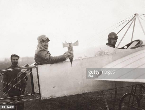 Bulgarian airmen prepare for a mission to drop a bomb by hand on Adrianople , from their Bleriot XI aircraft, during the First Balkan War, circa...