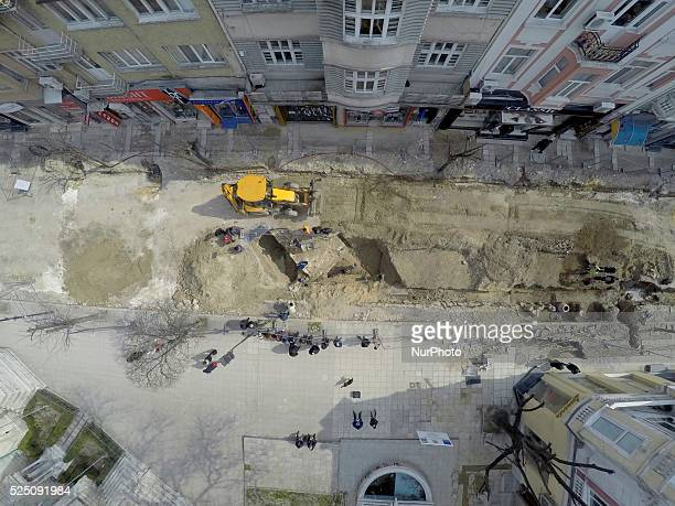 Bulgarian archaeologists work at newly discovered giant skeleton at the main street in the downtown of the Black sea town of Varna east of the...