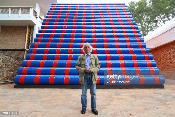 Bulgarian artist Christo poses in front of the monumental Mastaba art work at the Maeght Foundation on the opening day of the exibition on June 4...