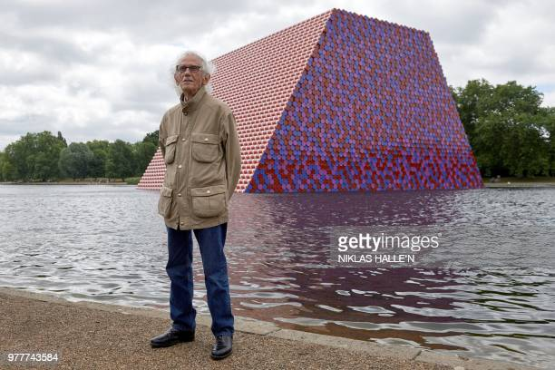 Bulgarian artist Christo Vladimirov Javacheff better known as 'Christo' poses for a photograph as he unveils his artwork 'The Mastaba' on the...