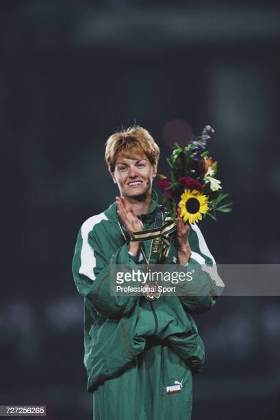 Bulgarian athlete Stefka Kostadinova celebrates on the medal podium after finishing in first place to win the gold medal in the Women's high jump...