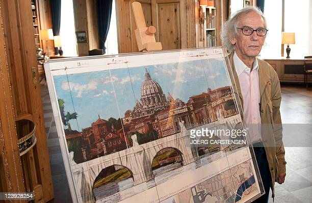US Bulgarian born artist Christo poses in front of a painting representing his work Ponte Sant' Angelo Wrapped on September 6 2011 in Berlin as he...