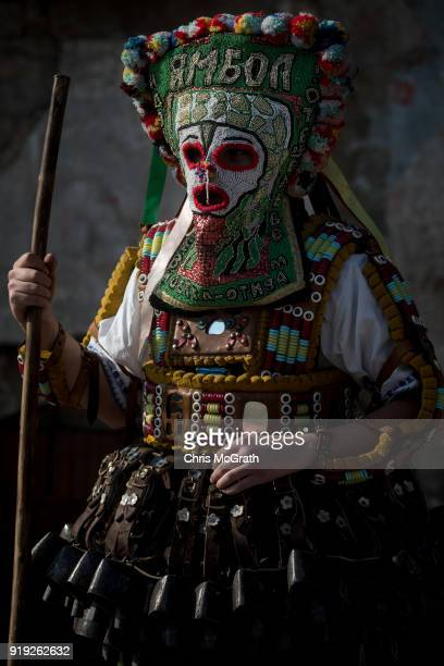Bulgarian dancer known as 'Kukeri' waits to perform during a festival on February 17 2018 in Edirne Turkey The Kukeri festival was held for the first...
