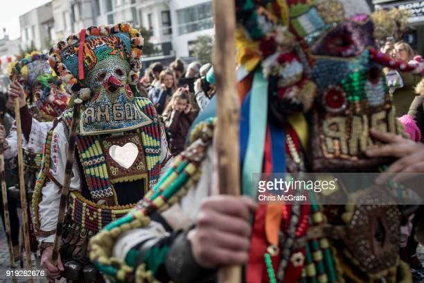 Bulgarian dancers known as 'Kukeri' perform in a street on February 17 2018 in Edirne Turkey The Kukeri festival was held for the first time in...