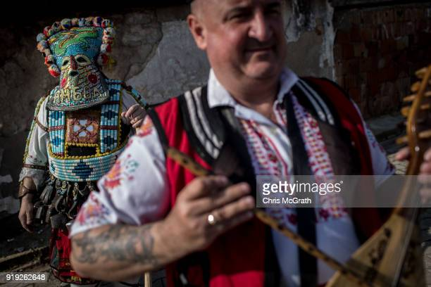 Bulgarian dancers known as 'Kukeri' prepare to perform during a festival on February 17 2018 in Edirne Turkey The Kukeri festival was held for the...