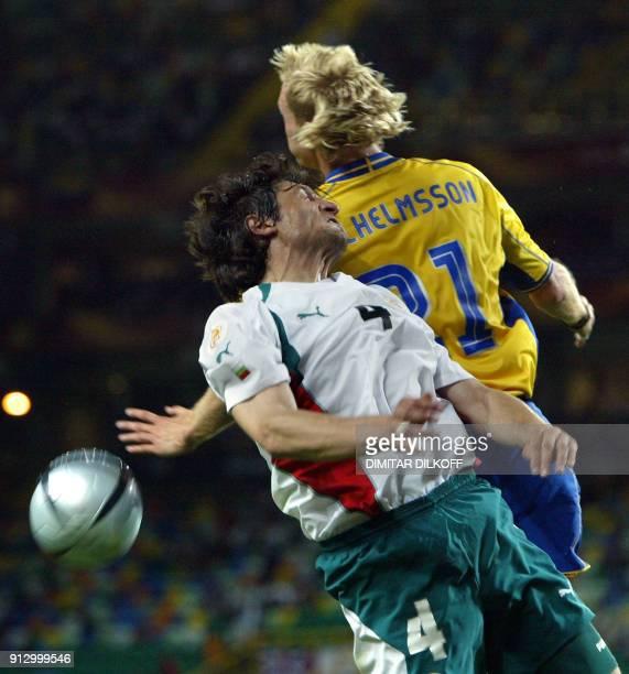 Bulgarian defender Ivailo Petkov and Sweden's midfielder Christian Wilhelmsson go for a head, 14 June 2004 at the Jose De Alvalade stadium in Lisbon...