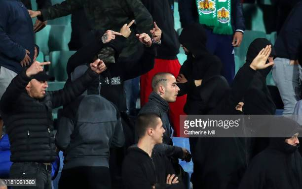 Bulgarian fans gesture during the UEFA Euro 2020 qualifier between Bulgaria and England on October 14, 2019 in Sofia, Bulgaria.