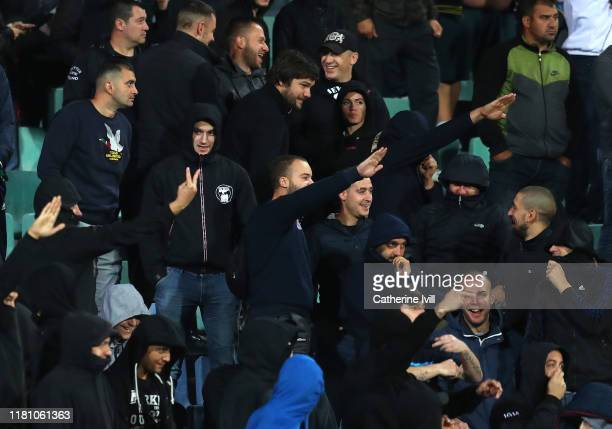 Bulgarian fans gesture during the UEFA Euro 2020 qualifier between Bulgaria and England on October 14 2019 in Sofia Bulgaria