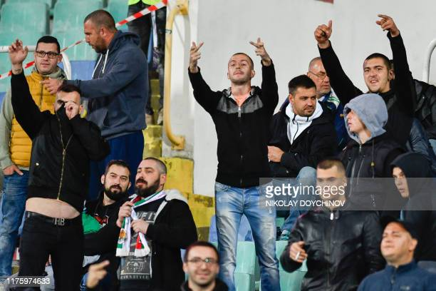 Bulgarian fans react during a temporary interruption of the Euro 2020 Group A football qualification match between Bulgaria and England due to...