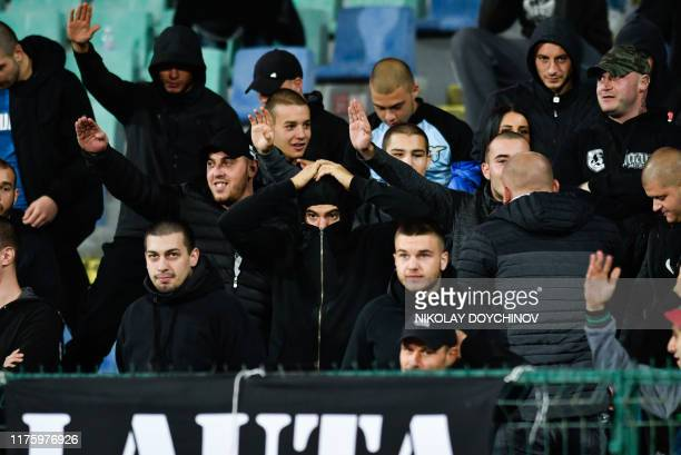 Bulgarian fans react during the Euro 2020 Group A football qualification match between Bulgaria and England at the Vasil Levski National Stadium in...