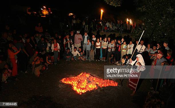 Bulgarian fire dance called Nestinarka rakes burning embers into a cross in the village of Varvara 09 September 2006 during a celebration of the...