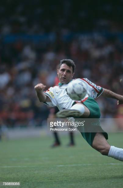 Bulgarian footballer and forward with the Bulgaria national team Hristo Stoichkov pictured in action with the ball during the group B match between...