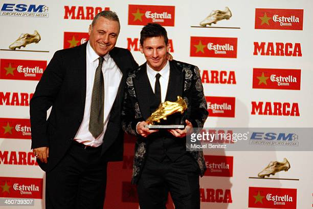 Bulgarian former football player Hristo Stoichkov hands over to Barcelona's Argentinian forward Lionel Messi his Golden Boot 2013 award presented to...
