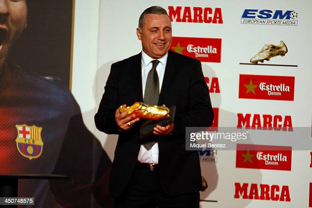 Bulgarian former football player Hristo Stoichkov poses ready to give the Golden Boot 2013 award to Lionel Messi presented to Europes best goal...