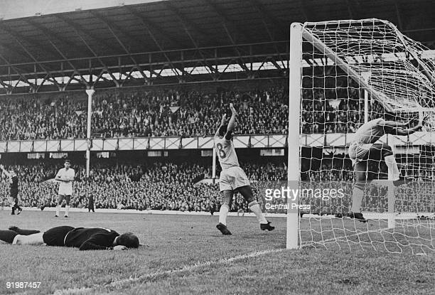 Bulgarian goalkeeper Georgi Naidenov lies prone on the ground after Brazilian forward Garrincha scored his country's second goal in the World Cup at...