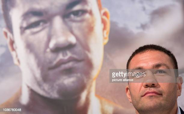 Bulgarian heavyweight boxer Kubrat Pulev attends a press conference with boxing promoter Kalle Sauerland andBritish boxer Dereck Chisora in Hamburg...