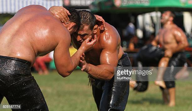 Bulgarian men fight in a traditional oil wrestling match near the village of Benkovski some 500 kms east of the capital Sofia Saturday Aug 16 2014...