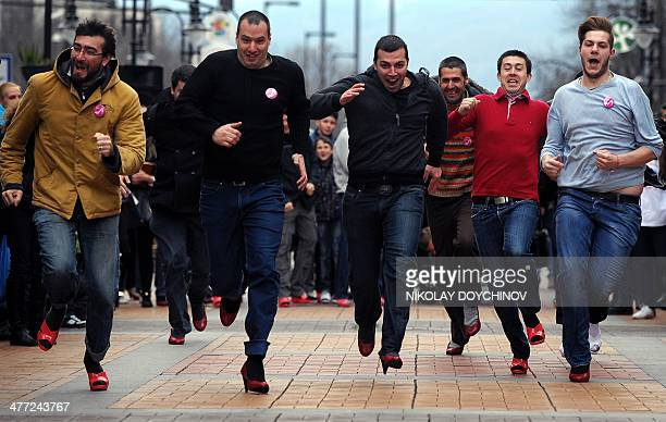 Bulgarian men wearing high heels run during the second edition of Bulgaria's 'Walk a Mile in Her Shoes' in Sofia on March 8 as part of an...