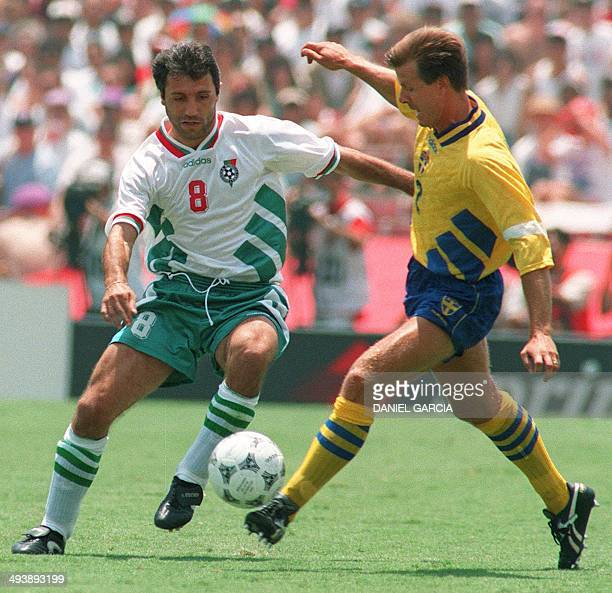 Bulgarian midfielder Hristo Stoichkov and Swedish defender Roland Nilsson battle for the ball during their World Cup soccer match for third place 16...