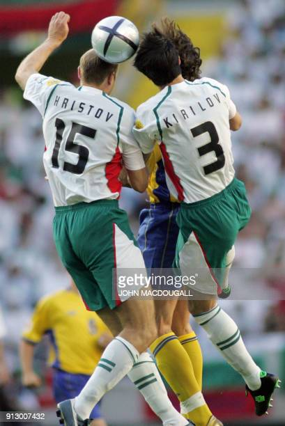 Bulgarian Midfielder Marian Hristov and his teammate defender Rossen Kirilov jump for the ball 14 June 2004 during their opening match of the...
