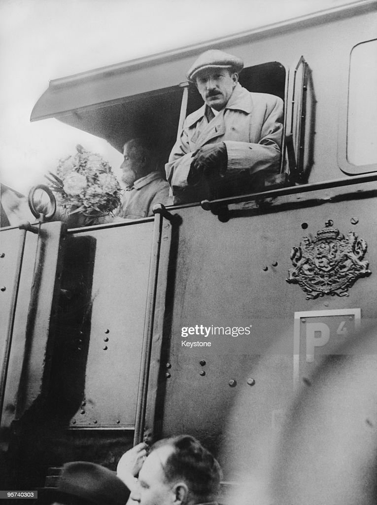 Bulgarian monarch and railway enthusiast King Boris III (1894 - 1943, right) in the driver's cab of a steam locomotive, circa 1935. The king enjoys travelling on the footplate as well as driving the train himself.
