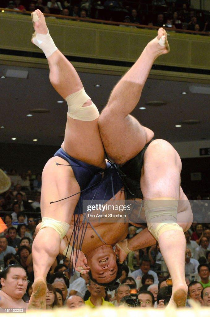 Bulgarian ozeki Kotooshu (R), whose real name is Kalojan Stefanov Mahljanov and Myogiryu compete during day four of the Grand Sumo Autumn Tournament at Ryogoku Kokugikan on September 18, 2013 in Tokyo, Japan.