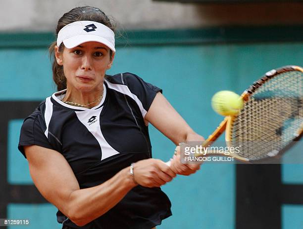 Bulgarian player Tsvetana Pironkova hits a return to her Chinese Taipei opponent YungJan Chan during their French tennis Open first round match at...