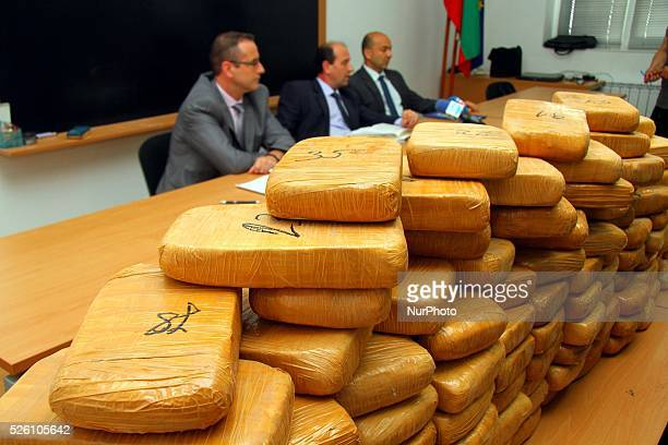 Bulgarian police investigators attend during a news conference as they show to the press 106 kilograms of heroin at the Kapitan Andreevo border check...