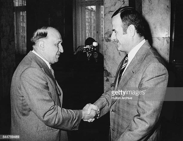 Bulgarian politician Todor Zhivkov , first Secretary of the Communist Party, shaking hands with State Council President Hafez al-Assad, at a meeting...