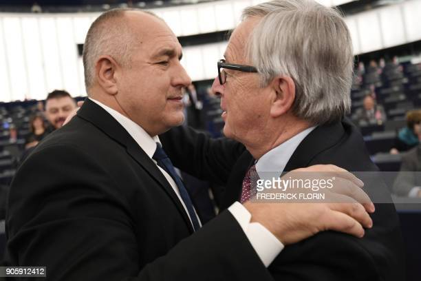 Bulgarian Prime Minister Boiko Borissov greets European Commission President JeanClaude Juncker following a debate as part of a plenary session at...
