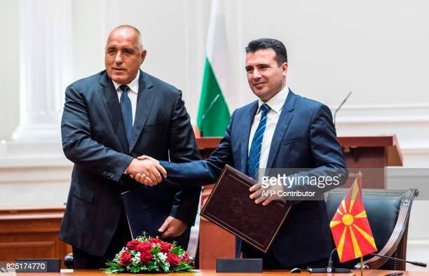 Bulgarian Prime Minister Boyko Borisov and Macedonian Prime Minister Zoran Zaev shake hands during the official signing ceremony of the Neighborhood...
