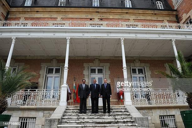 Bulgarian Prime Minister Boyko Borisov poses beside Turkish Prime Minister Recep Tayyip Erdogan and Qatari counterpart Sheikh Hamad bin Jassem...