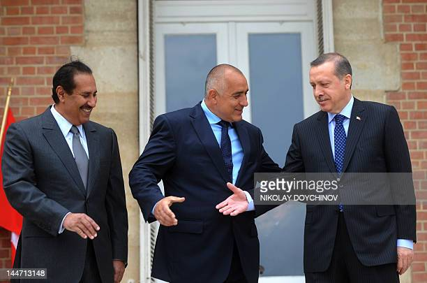 Bulgarian Prime Minister Boyko Borisov shakes hands with Turkish Prime Minister Recep Tayyip Erdogan and Qatari counterpart Sheikh Hamad bin Jassem...