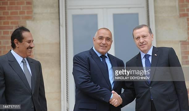 Bulgarian Prime Minister Boyko Borisov shakes hands with Turkish Prime Minister Recep Tayyip Erdogan as Qatari counterpart Sheikh Hamad bin Jassem...