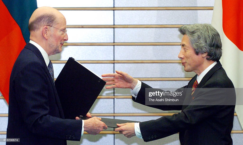 Bulgarian Prime Minister Simeon Saxe-Coburg-Gotha and Japanese Prime Minister Junichiro Koizumi exchange the documents during the signing ceremony after their meeting at Koizumi's official residence on December 15, 2004 in Tokyo, Japan.