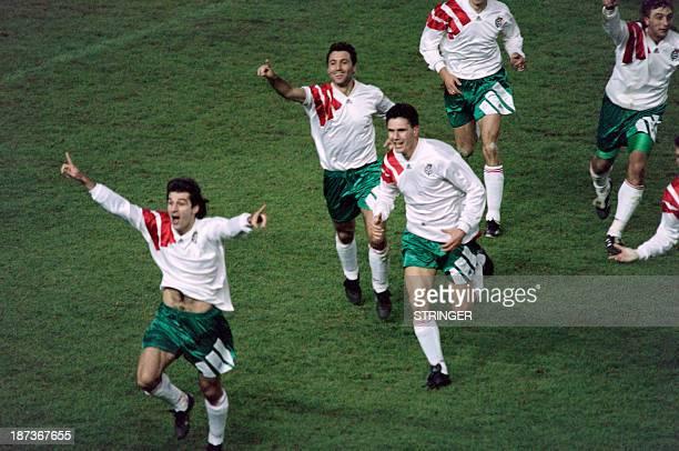 Bulgarian soccer players Emil Kostadinov Hristo Stoichkov Petar Alexandrov and Trifon Ivanov celebrate during a qualification match for the world cup...
