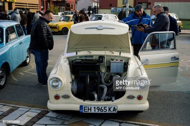 Bulgarian Trabant enthusiasts look on model 600 during a gathering to celebrate the 60th anniversary of the car in the town of Pavel Banya on...