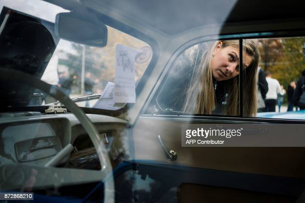 Bulgarian Trabant enthusiasts look the interior of a Trabant 600 during a gathering to celebrate the 60th anniversary of the car in the town of Pavel...