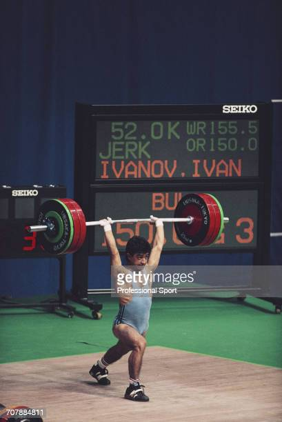 Bulgarian weightlifter Ivan Ivanov pictured in action to finish in first place to win the gold medal in the Men's flyweight weightlifting event at...