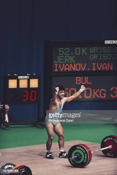 Bulgarian weightlifter Ivan Ivanov pictured raising his arms in the air in celebration during action to finish in first place to win the gold medal...