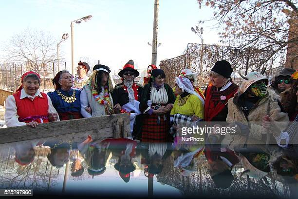 Bulgarian woman dressed up for carnival performs in celebration of the Midwives' Day in the village of Brestnik east of the Bulgarian capital Sofia...