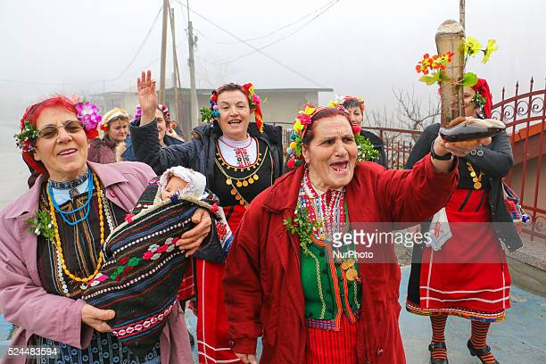 Bulgarian women dressed up for carnival performs in celebration of the Midwives' Day in the village of Topoli east of the Bulgarian capital Sofia...