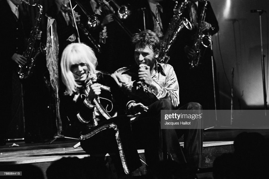 Bulgarian-born French singer Sylvie Vartan with her husband Johnny Hallyday on stage at the Olympia music hall.