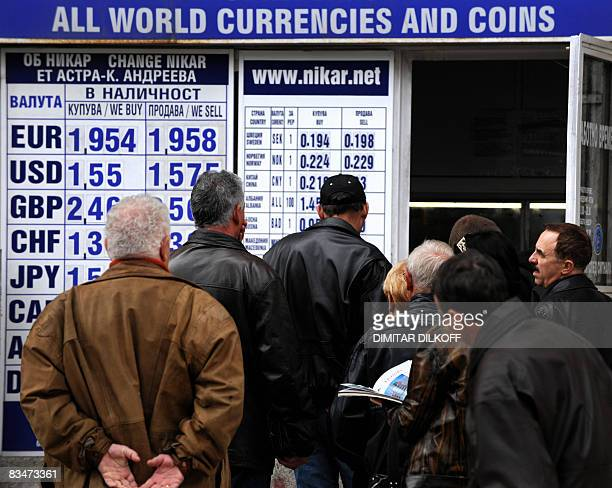 Bulgarians line up in front of a currency exchange office in Sofia on October 29 2008 Bulgarian officials and business leaders discussed possible...