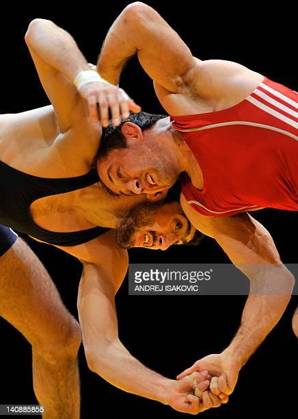 Bulgaria's Anatolie Ilarionovitch Guidea fights with Azerbaijan's Toghzul Asgarov during the men 60 kg freestyle final of the European Wrestling...