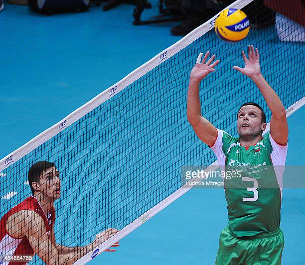 Bulgaria's Andrey Zhekov setting the ball during the FIVB World Championships match between Russia and Bulgaria on September 7 2014 in Gdansk Poland
