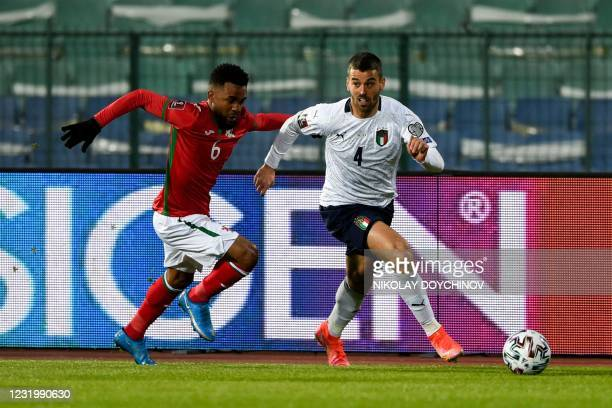 Bulgaria's defender Cicinho challenges Italy's defender Leonardo Spinazzola during the FIFA World Cup Qatar 2022 qualification Group C football match...