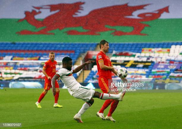 Bulgaria's defender Cicinho gets the ball past Wales' defender Ben Davies during the UEFA Nations League football match between Wales and Bulgaria at...